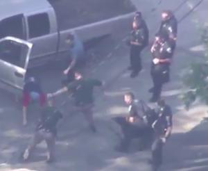 Officers watch beatdown